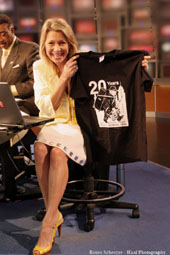 Fox 8 Morning show host Sefani Schaefer showing off her Colin Dussault's Blues Project 20th Anniversary T-Shirt